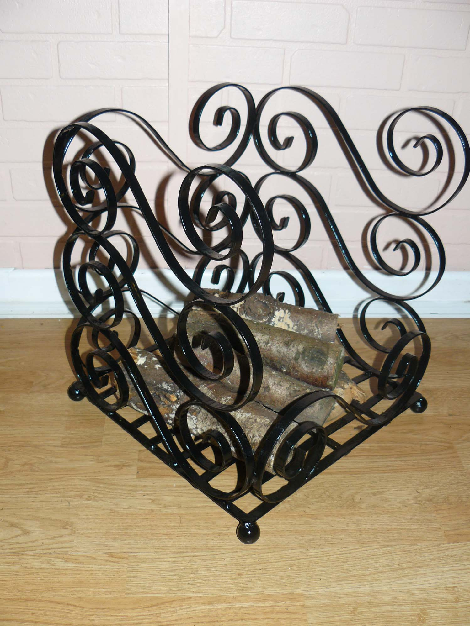 Scrolled log basket wimborne wrought iron works